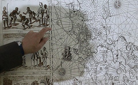 A Filipino businessman, Mel Velarde, pointing to a replica of a 1734 map he bought at auction in London that shows Scarborough Shoal as part of Philippine territory under Spanish rule. The Philippine government requested copies of historical maps for its arbitration case against China in The Hague.
